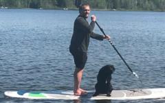 Corbett photo on lake with dog