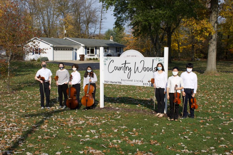 Student+musicians+in+front+of+nursing+home+country+woods+sign