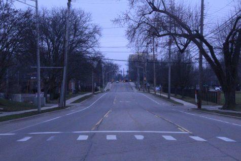 A grey car on empty Burcham road