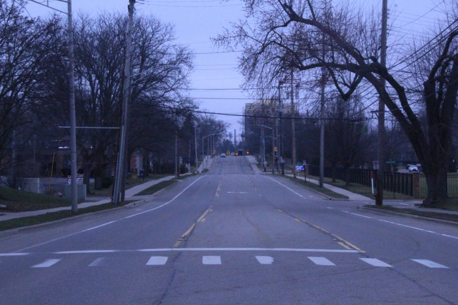 A+grey+car+on+empty+Burcham+road