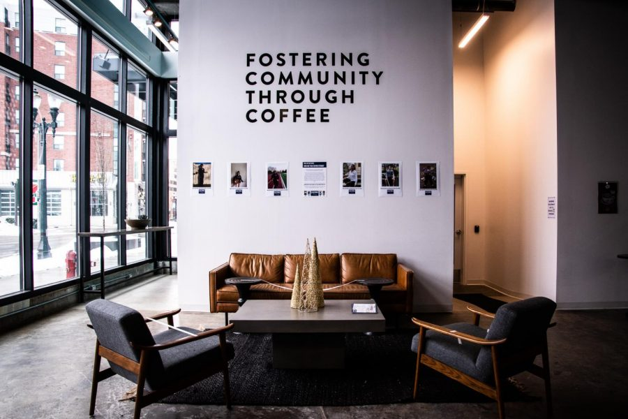 A photo of the inside of Foster Coffee. On the wall, it's written,