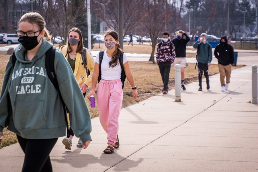 Students walking to school's main entrance.