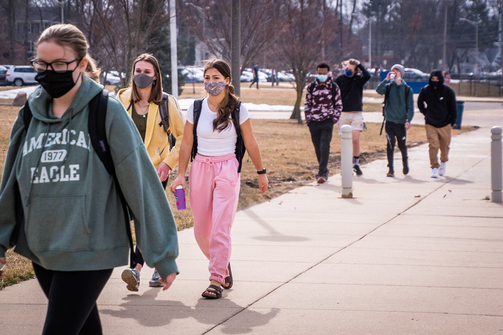 Students walk towards the main entrance in the morning.