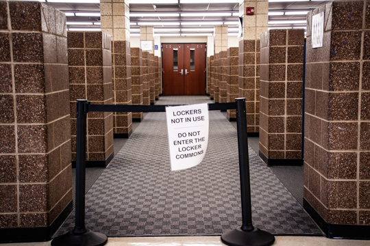 """Barriers in locker commons with a sign: """"Lockers not in use. Do not enter the locker commons."""""""