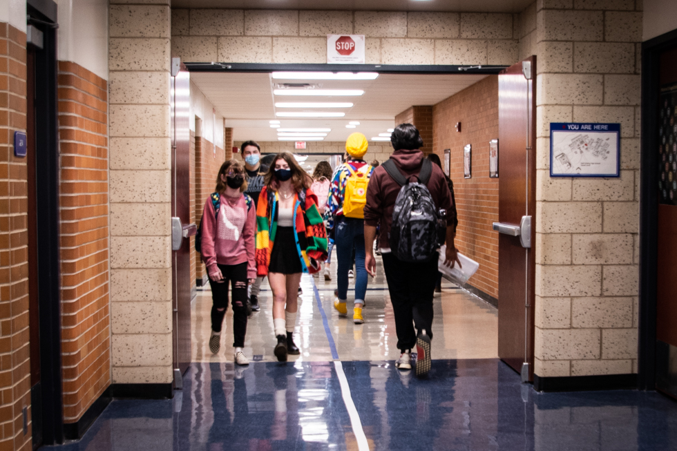 Students walking in the hallway in two different directions.
