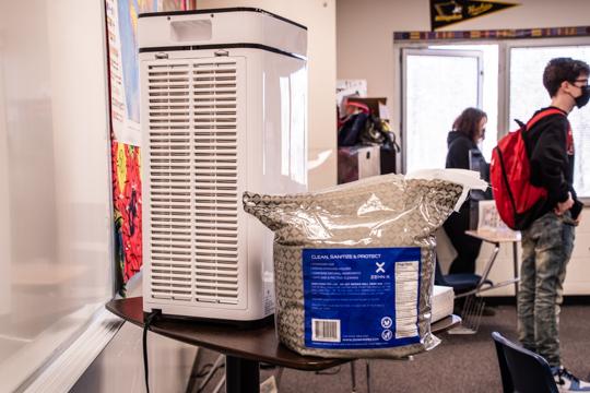 Air purifier and a bag of wipes in social studies teacher Ross Gorman's classroom.