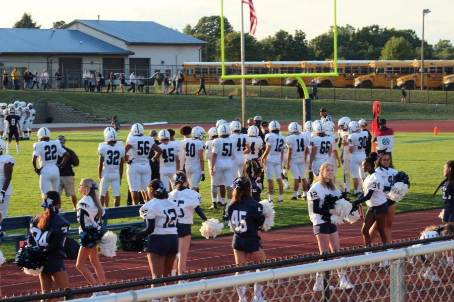 EL cheerleaders and football team