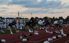 The East Lansing varsity cheer on Sept. 24 at an away game in DeWitt, cheer will accompany the football team as well as engage with the visiting student section.