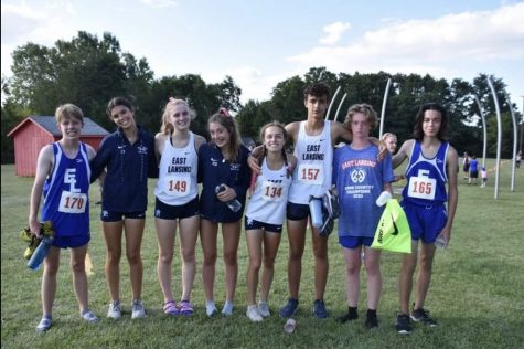 David Fort (11), Grace Rose (11), Barbara Stout (11), Esther Waller (12), Anna Delgado (11), Eden Lampi (10), Sean Flemming (12), and Eli Burch (10) pose for a picture at the Saranac Invitational September 2nd.  Photo Credit: Regina Stout